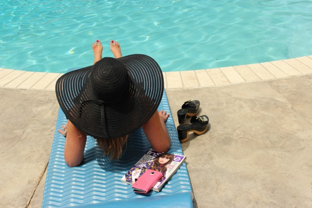 Poolside, black floppy hat The OP Life