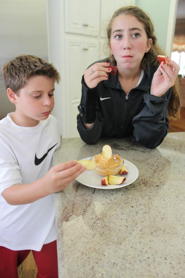 Kids eating apples and pumpkin dip The OP Life