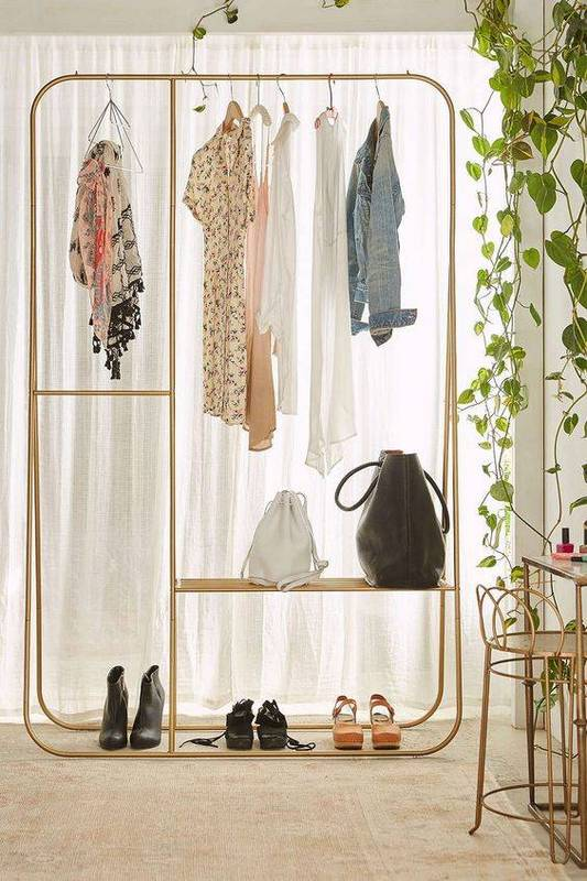 35-spare-bedrooms-that-turned-into-dream-closets-turn-room-into-walk-in-closet-urban-outfitters-clothing-rack-572faeb31f1859cc5a971f30-w620_h800