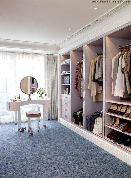 35-spare-bedrooms-that-turned-into-dream-closets-turn-room-into-walk-in-closet-walk-in-closet-with-blue-rug-572fae594bf0acca5a4137f2-w620_h800
